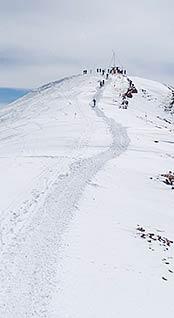 Nearing the summit on the hike to Highland Bowl. Photo courtesy aspenportriat.com