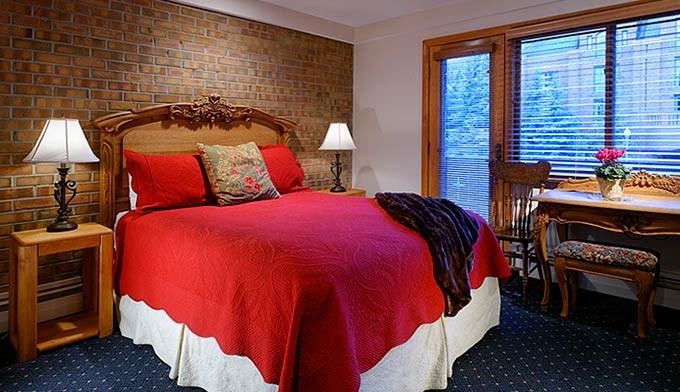 All of our rooms are unique in size, layout and decor. This photo is an example of this room type.